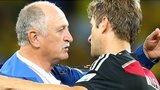 Brazil coach Luiz Felipe Scolari with Thomas Muller of Germany