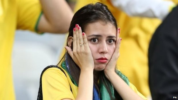 A Brazilian fan reacts during the match