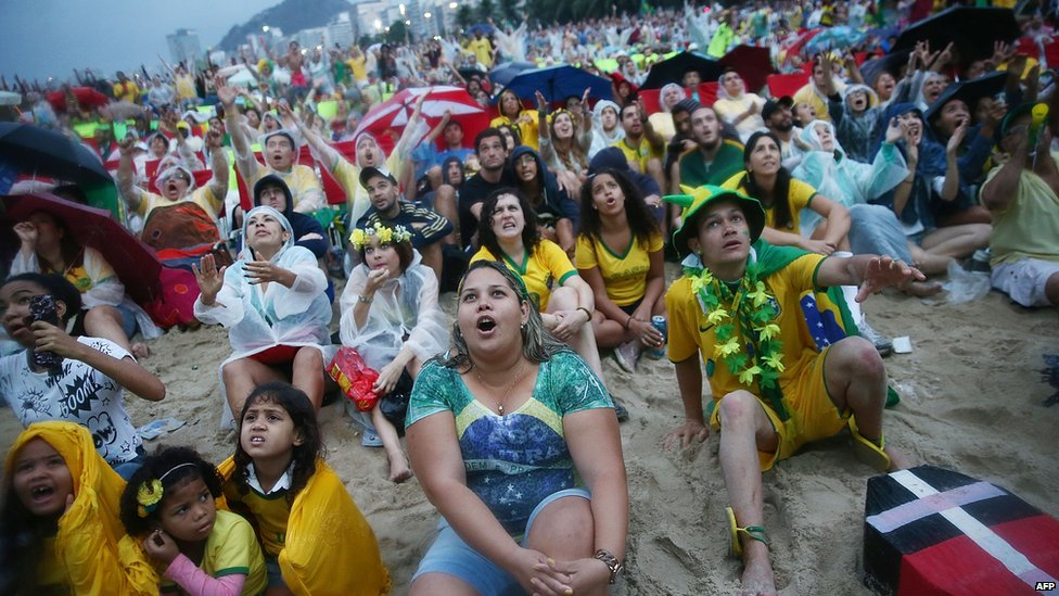 Brazil fans watch the first half on Copacabana Beach during the 2014 FIFA World Cup semi-final match between Brazil and Germany on 8 July 2014