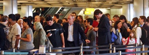 People queuing at Heathrow in 2011