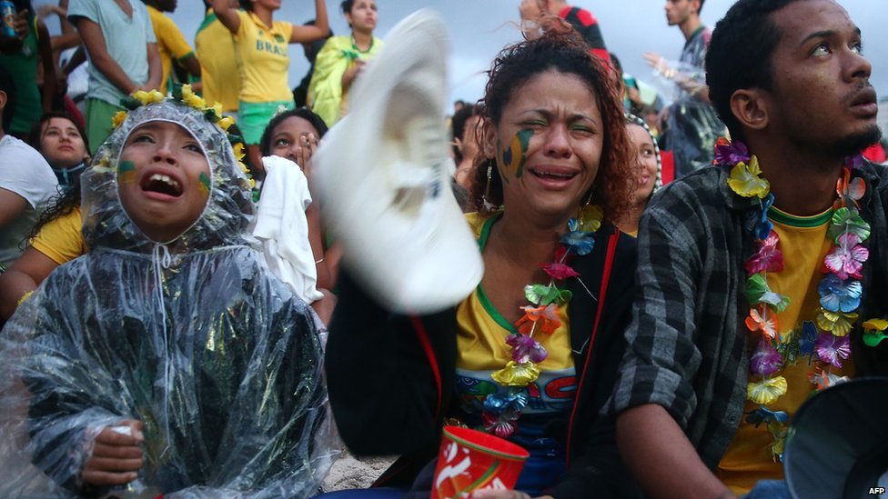 Crying Brazil fans while watching the first half on Copacabana Beach during the 2014 FIFA World Cup semi-final match between Brazil and Germany on 8 July 2014