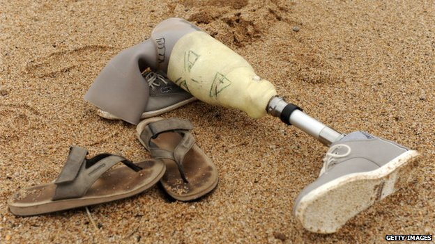 Prosthetic leg on the beach