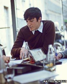 Matteo Achilli in a cafe