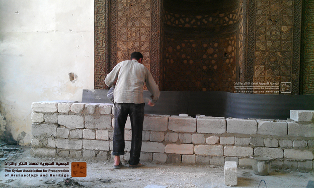 A man building a protective wall