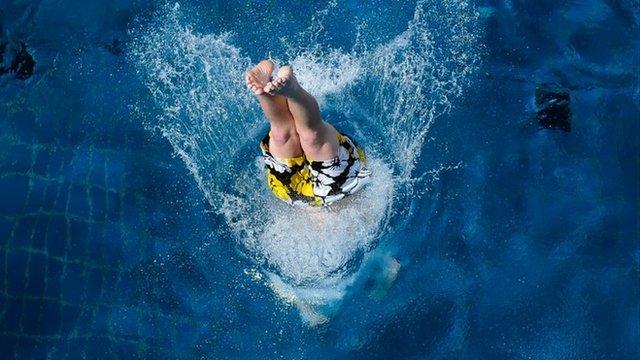 Boy diving