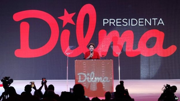 President Dilma Rousseff speaks to supporters at the Workers Party national convention in Brasilia on 21 June, 2014
