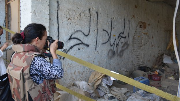 Reporter takes photo of closed off room in Miranshah
