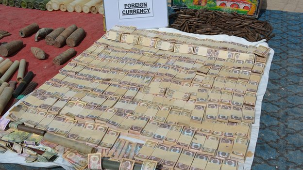 Wads of foreign currency notes in Miranshah