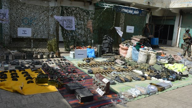 Weapons and ammunition laid out on ground in Miranshah