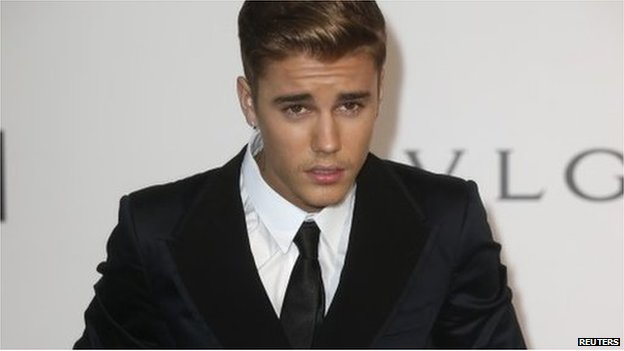 "Canadian pop singer Justin Bieber arrives for amfAR""s Cinema Against AIDS 2014 event in Antibes during the 67th Cannes Film Festival 22 May 2014"