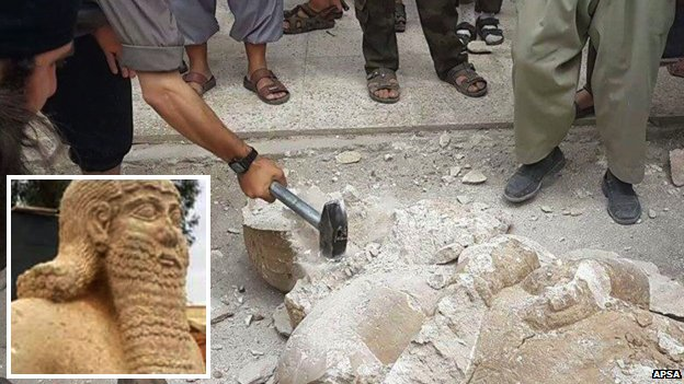 Isis fighters destroying a statue