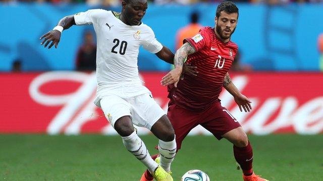 Kwadwo Asamoah of Ghana and Vieirinha of Portugal compete for the ball