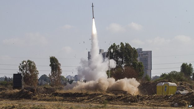 An Isreali defence missile fires to intercept a rocket from the Gaza Strip in Tel Aviv on 9 July