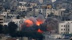 Flames erupt from a building hit by an Israeli air strike in Gaza City. Photo: 9 July 2014