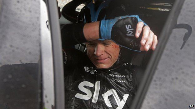 Chris Froome is collected by a Team Sky car after pulling out of Le Tour de France