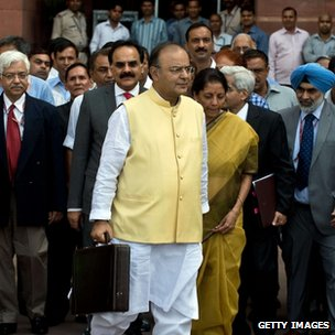 Indian Finance Minister Arun Jaitley leaves his office to table the budget in parliament in New Delhi.