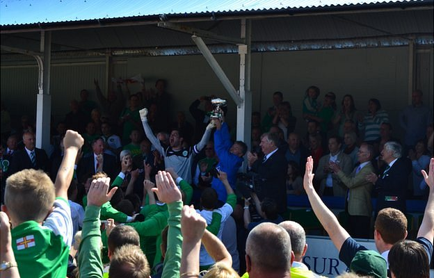 Guernsey goalkeeper Chris Tardif lifts the Muratti trophy in 2013 at The Track