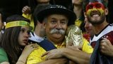 Brazil fan holds the World Cup trophy during the 7-1 semi-final defeat by Germany