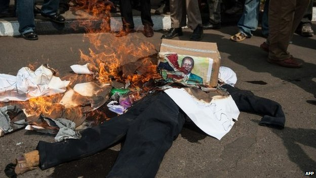 An effigy of Kenyan opposition leader Raila Odinga burns in Nairobi on 18 June 2014
