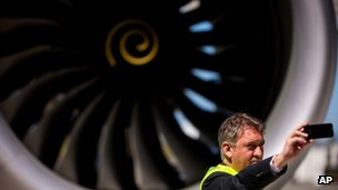 A man takes a selfie in front of an Air New Zealand Boeing 787-9 Dreamliner