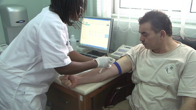 Man having blood test in Ghanaian clinic