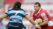 Ken Owens, of Scarlets, takes on Cardiff Blues' Josh Navidi