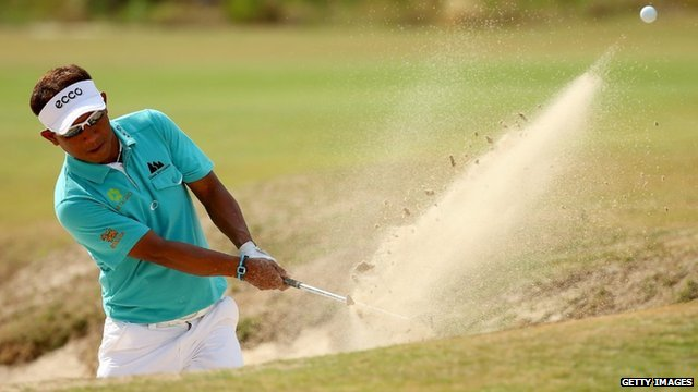 Thongchai Jaidee of Thailand hits a shot