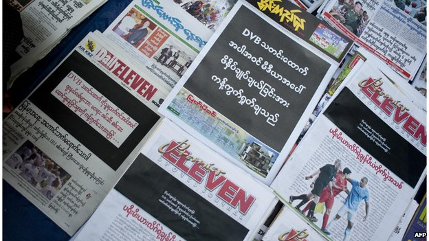 Newspapers with a black front page are displayed at a stall in Yangon on April 11, 2014, after Zaw Pe, a journalist for the Democratic Voice of Burma (DVB) news website, was convicted of trespassing and 'disturbing a civil servant' by a court in the central town of Magway on 7 April.
