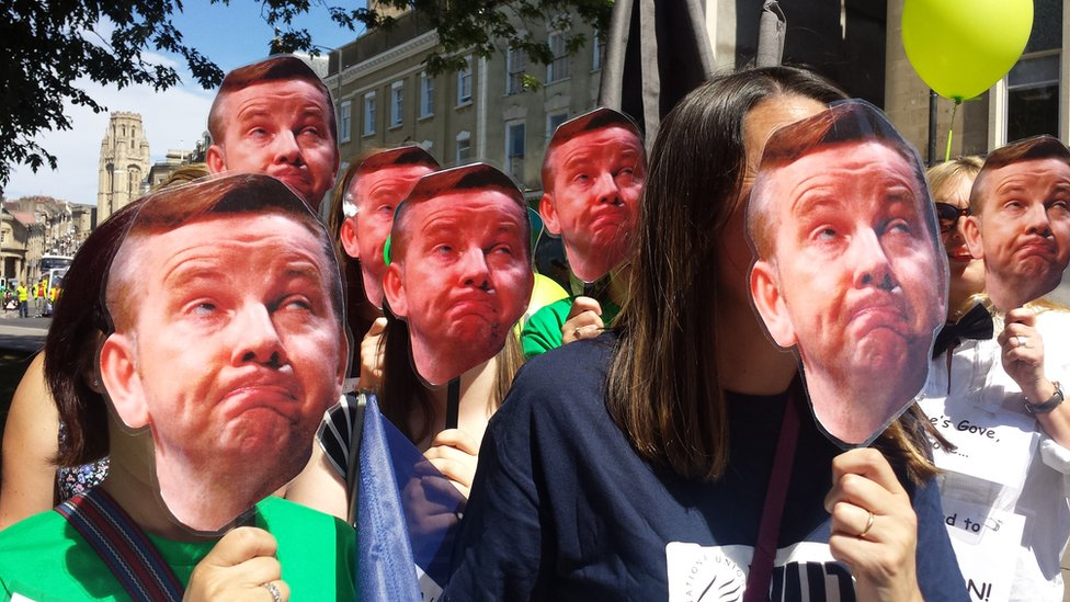 Public sector workers striking in Bristol with Michael Gove masks.
