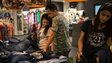 In this July 6, 2014 photo, shoppers at a sale at a clothing store in a mall in Delhi.