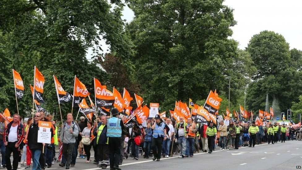 GMB union members march through Brighton.