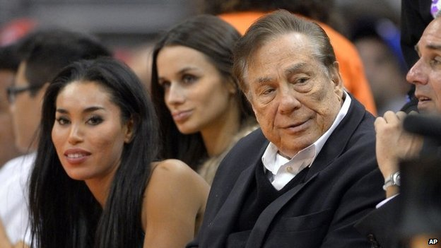 LA Clippers owner Donald Sterling (right) and V. Stiviano (left) watch the team play in LA on 25 October 2013