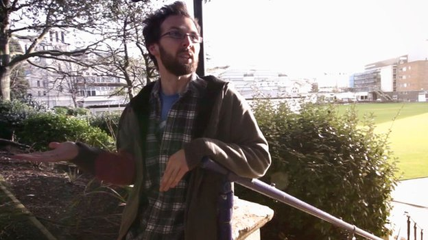 John appearing in the film, he's outside and seems to be mid-conversation