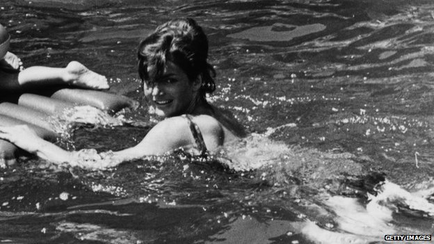 Jacqueline Kennedy swims with her daughter during an Italian vacation in 1962.