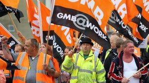 Members of the GMB union make their way through Brighton
