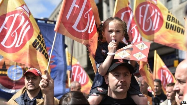 Public sector worker Scott Clarke with six-year-old daughter Amber Clarke during a march through Newcastle city centre.
