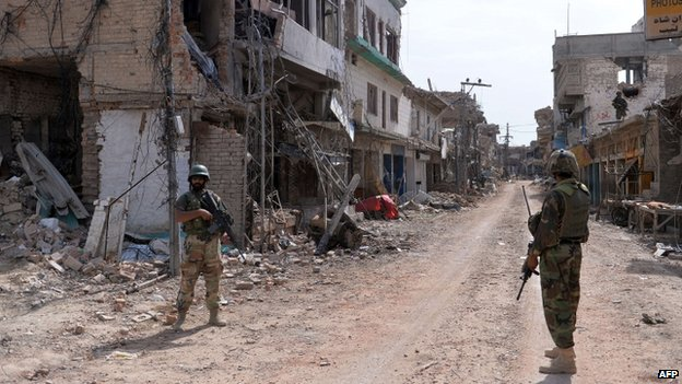 Pakistani soldiers patrol through the town of Miranshah in North Waziristan (July 2014)