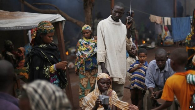 Muslim refugees listen to a radio at the Catholic church in Carnot, Central African Republic - April 2014
