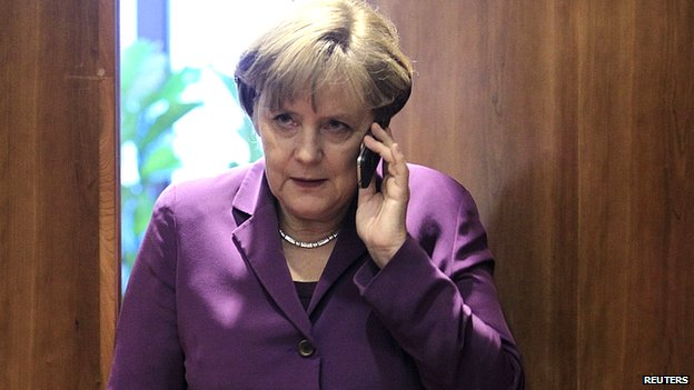 File image of Angela Merkel using mobile phone. 9 Dec 2011