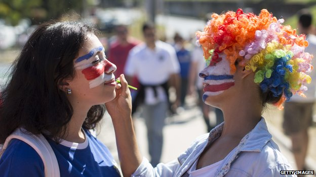 Fans paint their faces for the England-Costa Rica match