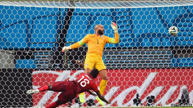Silvestre Varela of Portugal scores a goal as US goalkeeper Tim Howard looks on