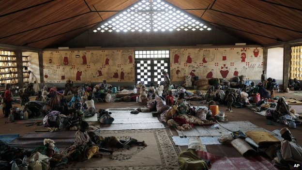 Muslims rest inside the Catholic church in Carnot, Central African Republic - April 2014
