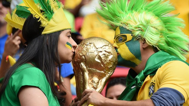 Fans kiss replica World Cup