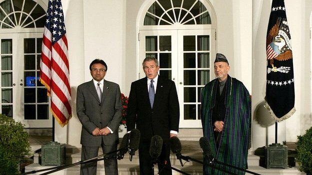 President George W Bush makes a statement with then Pakistani President Gen Pervez Musharraf and Afghan President Hamid Karzai 27 Sept 2006, in the Rose Garden at the White House.