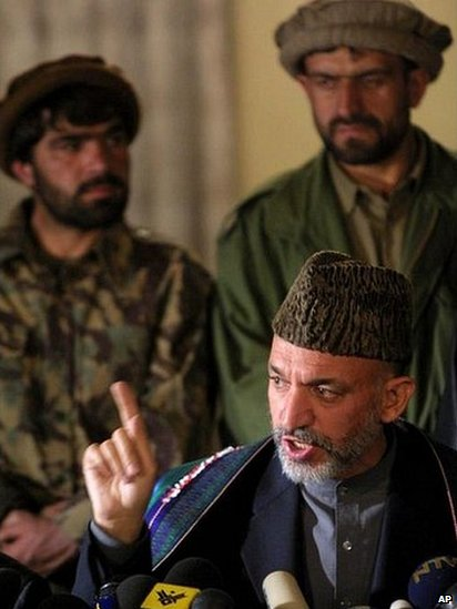 Newly-sworn in Afghan Prime Minister Hamid Karzai gestures while responding to a question from a member of the media, at a news conference, in the Afghan capital Kabul, Saturday, Dec. 22, 2001.