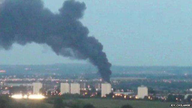 Mobile phone image of smoke rising near flats