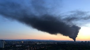 Smoke rises across Glasgow from the fire