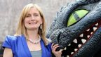 Author Cressida Cowell and Toothless the dragon