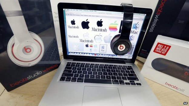 Beats headphones and an Apple laptop