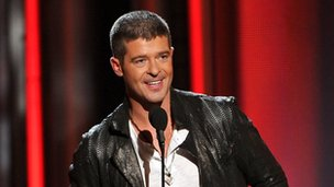 "Robin Thicke accepting the award for top R^B song for ""Blurred Lines"" at the Billboard Music Awards in Las Vegas"